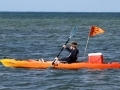Kayaker supporting a swimmer