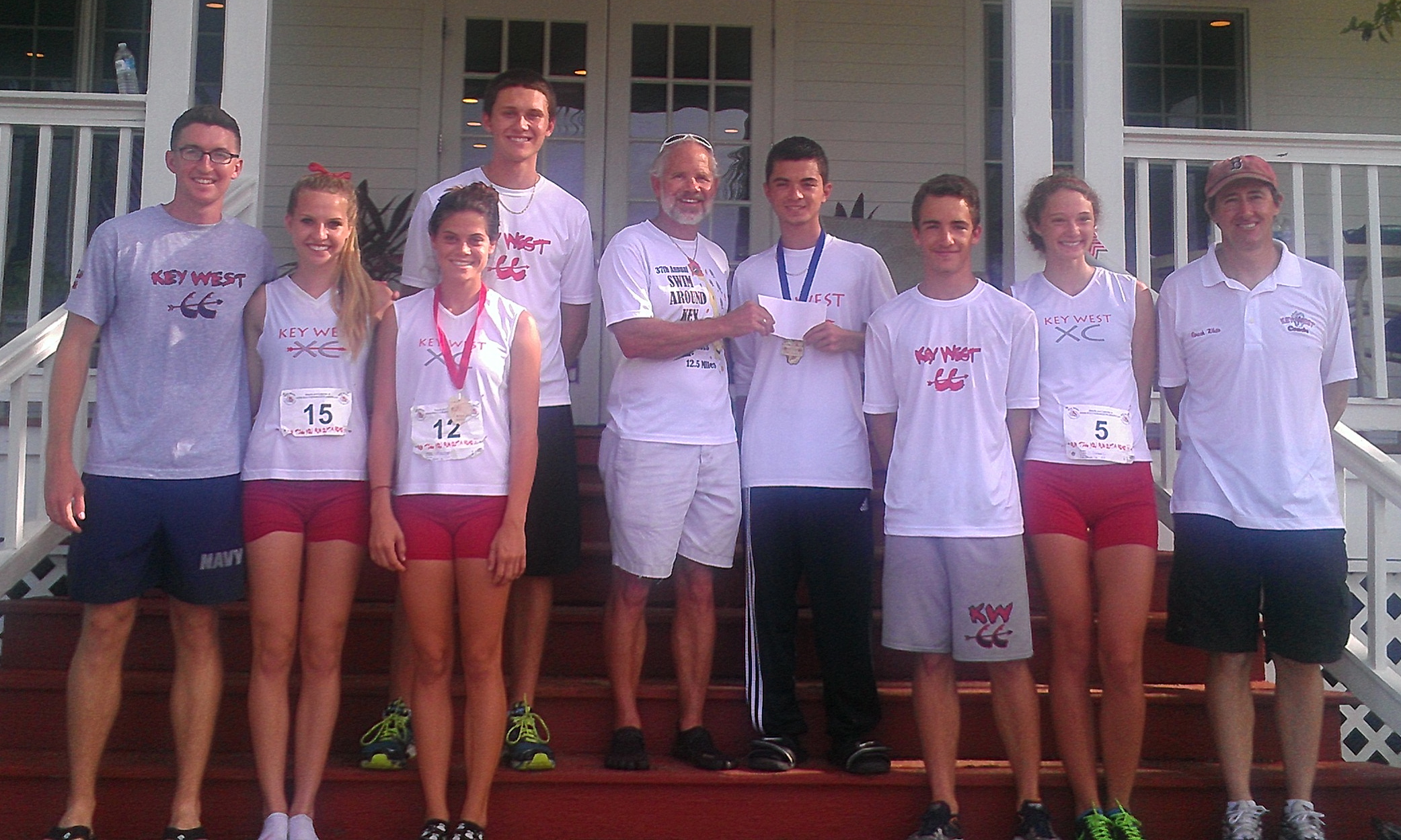 Presenting a donation check to the Key West Cross Country Team